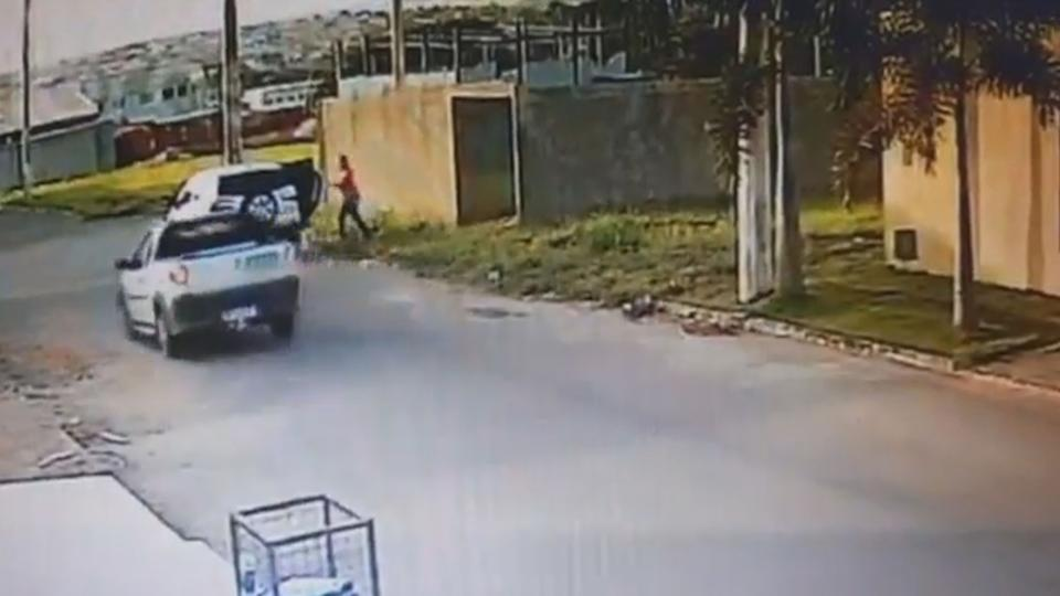 A CCTV still of a woman standing at a car near the Brazil crime scene.
