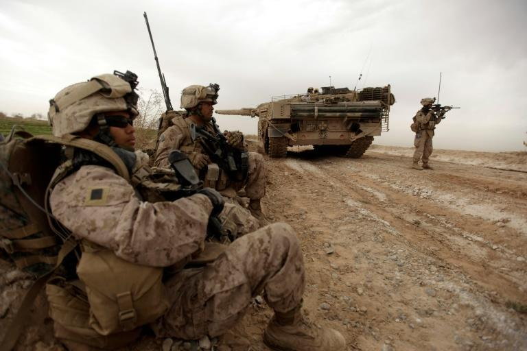In this file photo taken on February 21, 2010, US Marines clear Improvised Explosive Devices from a main route in Trikh Nawar on the outskirts of Marjah