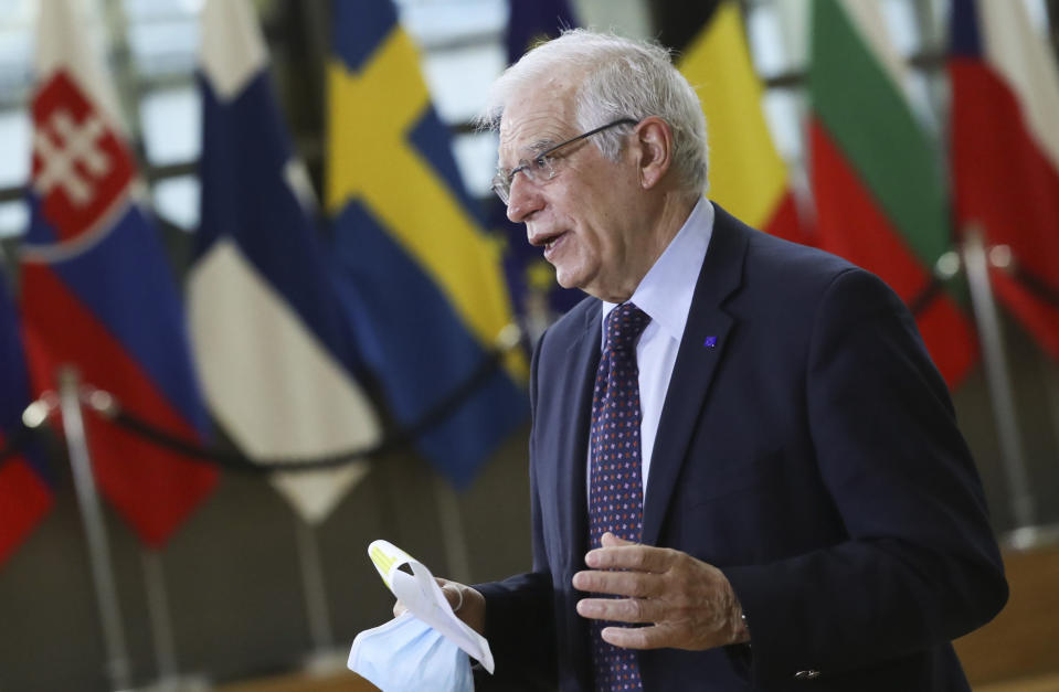 European Union foreign policy chief Josep Borrell speaks to the media as he arrives for a meeting of EU foreign ministers at the European Council building in Brussels, Monday, Feb 22, 2021. European Union foreign ministers on Monday will look at options for imposing fresh sanctions against Russia over the jailing of opposition leader Alexei Navalny as the 27-nation bloc considers the future of its troubled ties with the country. (Yves Herman, Pool via AP)