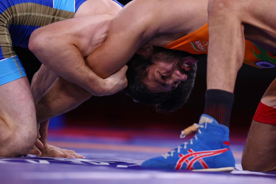 Tokyo 2020 Olympics - Wrestling - Freestyle - Men's 57kg - Gold medal match - Makuhari Messe Hall A, Chiba, Japan - August 5, 2021. Ravi Kumar of India in action against Zavur Uguev of the Russian Olympic Committee. REUTERS/Leah Millis