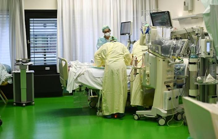 Nurses take care of a Covid-19 patient in the intensive care unit of the university hospital in Aachen, Germany