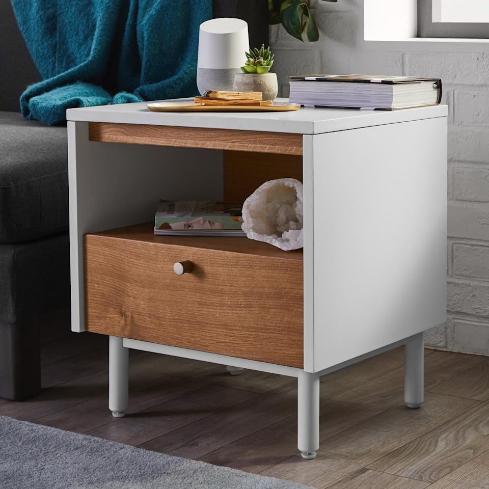 "<p>Get this <a href=""https://www.popsugar.com/buy/MoDRN-Scandinavian-Finna-Side-Table-413704?p_name=MoDRN%20Scandinavian%20Finna%20Side%20Table&retailer=walmart.com&pid=413704&price=149&evar1=casa%3Aus&evar9=45950398&evar98=https%3A%2F%2Fwww.popsugar.com%2Fphoto-gallery%2F45950398%2Fimage%2F45950578%2FMoDRN-Scandinavian-Finna-Side-Table&list1=shopping%2Chome%20decor%2Cfurniture%2Cwalmart%2Chome%20shopping&prop13=api&pdata=1"" rel=""nofollow"" data-shoppable-link=""1"" target=""_blank"" class=""ga-track"" data-ga-category=""Related"" data-ga-label=""https://www.walmart.com/ip/MoDRN-Scandinavian-Finna-Side-Table/928091411"" data-ga-action=""In-Line Links"">MoDRN Scandinavian Finna Side Table</a> ($149) if you need bedside storage.</p>"