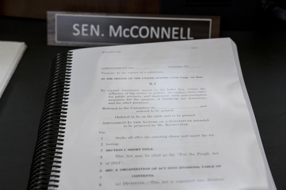 A book of amendments awaits Senate Minority Leader Mitch McConnell of Ky., at a Senate Rules Committee hearing at the Capitol in Washington, Tuesday, May 11, 2021. (AP Photo/J. Scott Applewhite)