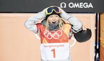 <p>US Snowboarder Chloe Kim was only 17 when she won the halfpipe gold medal at the 2018 Winter Olympics in South Korea with her 98.25 score. She wore a luxurious gray furry neck wrap on that day, later swapping it out for an oatmeal colored USA knit beanie.</p>
