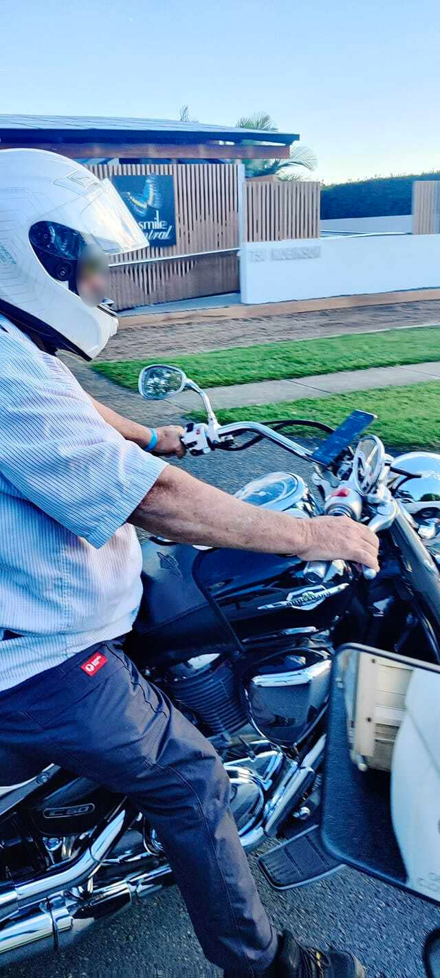 The Australia Post worker was accused of playing games on his phone while riding his motorbike.  Source: Supplied