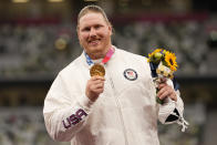 Gold medalist Ryan Crouser, of the United States, poses during the medal ceremony for the men's shot put at the 2020 Summer Olympics, Thursday, Aug. 5, 2021, in Tokyo. (AP Photo/Martin Meissner)
