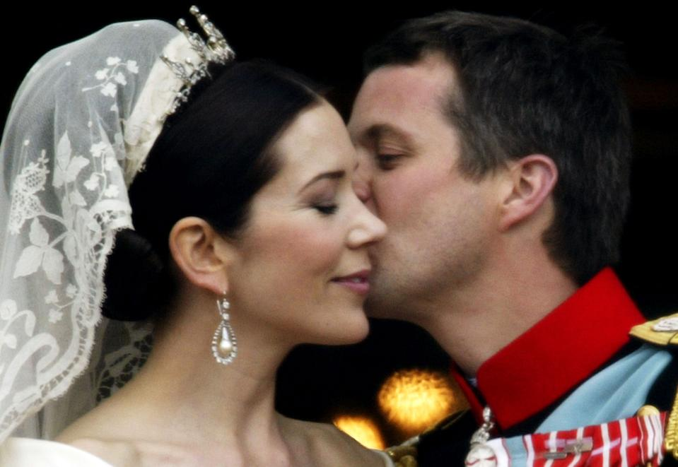 Princess Mary and Crown Prince Frederik of Denmark kiss as the Royal couple appear on the balcony