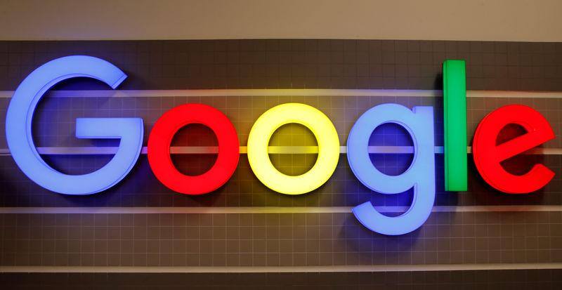FILE PHOTO: An illuminated Google logo is seen inside an office building in Zurich