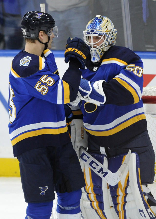 St. Louis Blues' Jordan Binnington (50) is congratulated by Colton Parayko (55) after the team's 2-1 victory over the Minnesota Wild in an NHL hockey game Wednesday, Oct. 30, 2019, in St. Louis. (AP Photo/Bill Boyce)