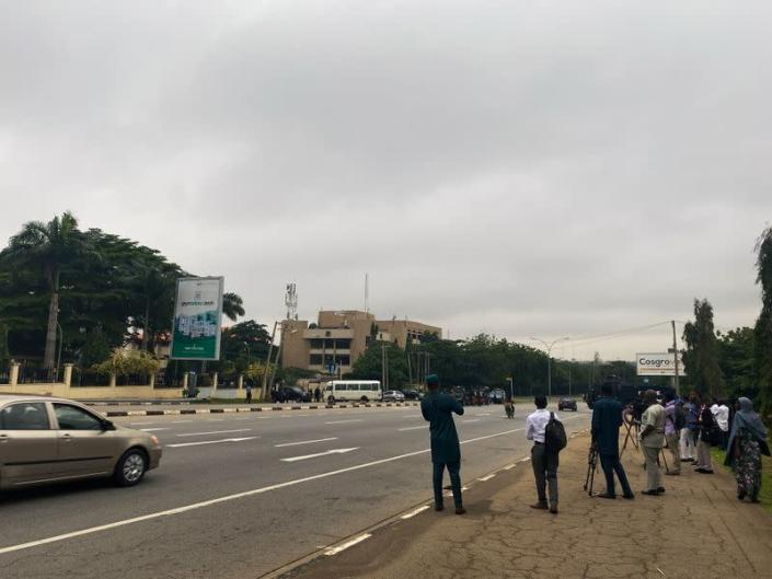 Journalists are seen stationed outside the Federal High Court as they await the arrival of IPOB leader Nnamdi Kanu at the court in Abuja