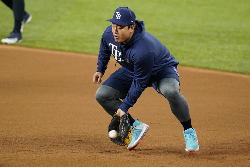 Tampa Bay Rays first baseman Ji-Man Choi takes part in a practice at Globe Life Field as the team prepares for the baseball World Series against the Los Angeles Dodgers, in Arlington, Texas, Wednesday, Oct. 14, 2020. (AP Photo/Eric Gay)