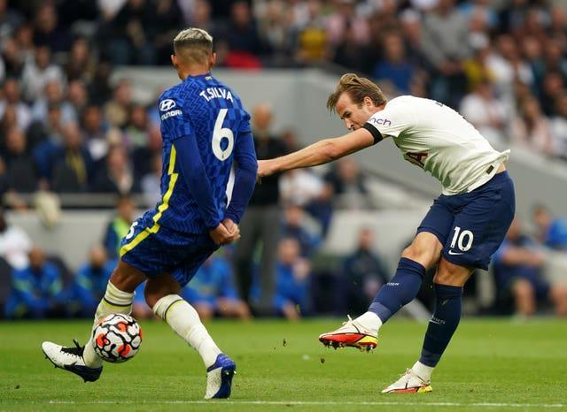 Harry Kane, right, takes a shot under pressure from Chelsea's Thiago Silva