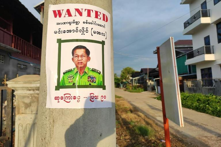 """Wanted posters of junta leader Senior General Min Aung Hlaing were pasted around town, calling him a """"power addict"""""""