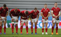 Welsh players bow to the crowd following their Rugby World Cup Pool D game against Georgia at Toyota City Stadium, Toyota City, Japan, Monday, Sept. 23, 2019.Wales defeated Georgia 43-14. (AP Photo/Christophe Ena)