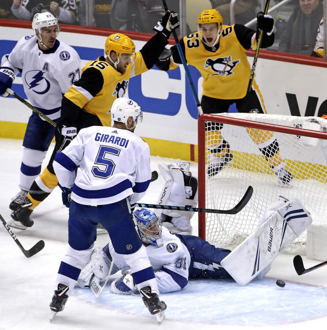Pittsburgh Penguins' Riley Sheahan (15) celebrates his goal past sprawling Tampa Bay Lightning goaltender Andrei Vasilevskiy (88) with Teddy Blueger (53) during the first period of an NHL hockey game in Pittsburgh, Wednesday, Jan. 30, 2019. (AP Photo/Gene J. Puskar)