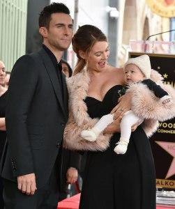 Adam Levin, Behati Prinsloo and their daughter Dusty Rose.