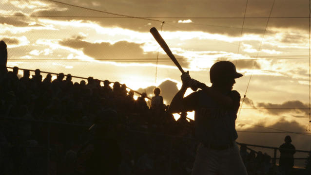 FILE - In this June 21, 2006, file photo, Beatrice Bruins' Travis Tucker takes his turn at bat during the fifth inning of the Midnight Sun game between the Bruins and the Alaska Goldpanners in Fairbanks, Alaska. The Alaska Baseball League has canceled its summer season, as the future of sports worldwide remains uncertain during the coronavirus pandemic. The league website says this season will be canceled to keep everyone safe from exposure to COVID-19. (AP Photo/Nora Gruner, File)