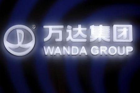 A sign of Dalian Wanda Group in China glows during an event announcing strategic partnership between Wanda Group and FIFA in Beijing