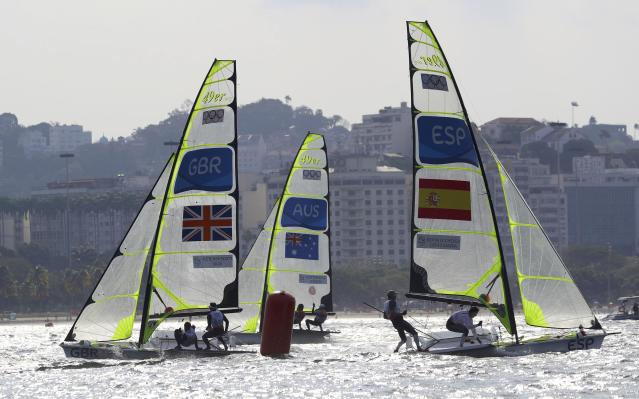 2016 Rio Olympics - Sailing - Final - Men's Skiff - 49er - Medal Race - Marina de Gloria - Rio de Janeiro, Brazil - 18/08/2016. Dylan Fletcher (GBR) of Britain and Alain Sign (GBR) of Britain, Nathan Outteridge (AUS) of Australia and Iain Jensen (AUS) of Australia and Diego Botin (ESP) of Spain and Iago Lopez (ESP) of Spain compete during medal race. REUTERS/Brian Snyder FOR EDITORIAL USE ONLY. NOT FOR SALE FOR MARKETING OR ADVERTISING CAMPAIGNS.