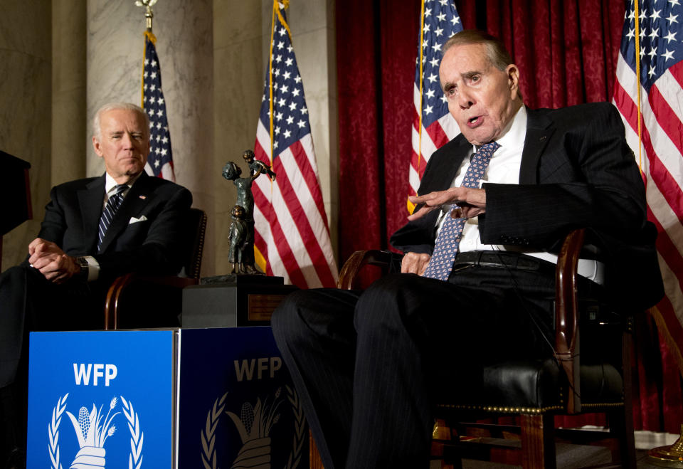 FILE - In this Dec. 11, 2013, file photo former Senate Majority Leader Bob Dole, right, speaks after being presented with the McGovern-Dole Leadership Award by Vice President Joe Biden, left, to honor his leadership in the fight against hunger, during the 12th Annual George McGovern Leadership Award Ceremony hosted by World Food Program USA, on Capitol Hill in Washington. President Biden is paying a visit to Dole, days after the former GOP presidential contender and World War II veteran announced he'd been diagnosed with stage 4 lung cancer. (AP Photo/Manuel Balce Ceneta, File)