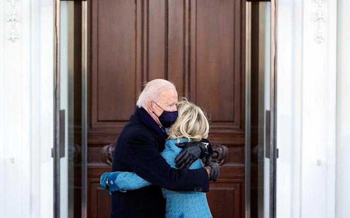 President Joe Biden and Dr. Jill Biden embrace before entering the White House - Alex Brandon/POOL/CNP/startraksphoto.com /STARTRAKS PHOTO