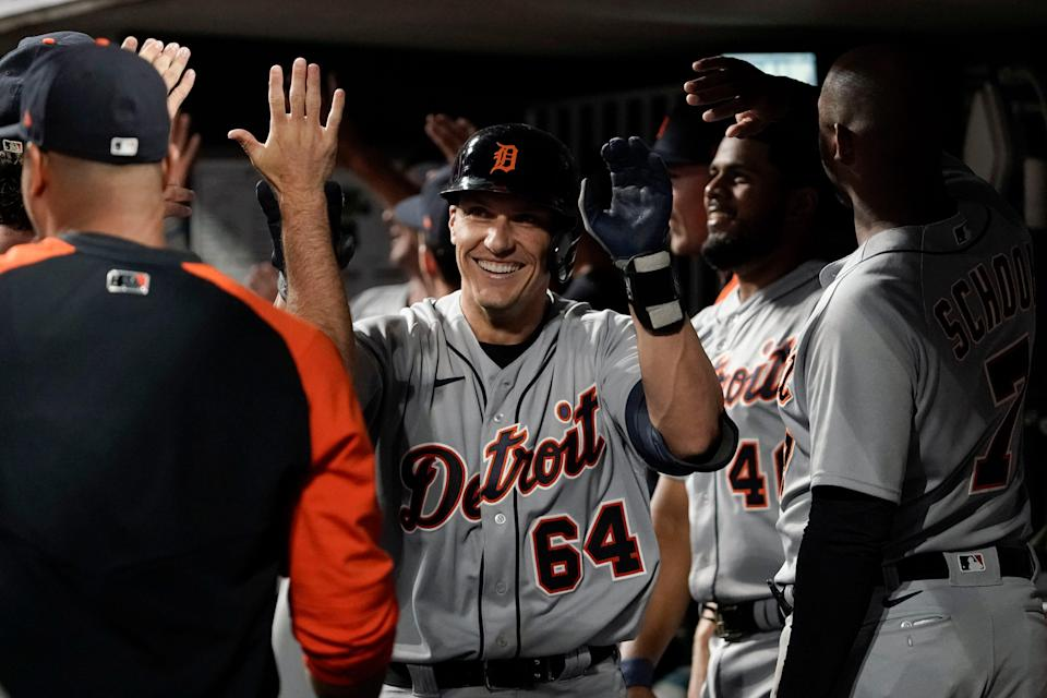 Tigers catcher Dustin Garneau celebrates with teammates after hitting a two-run home run during the sixth inning on Friday, Sept. 3, 2021, in Cincinnati.