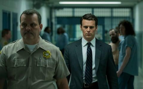 Jonathan Groff (right) stars as special agent Holden Ford