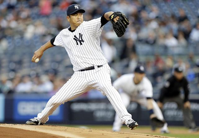 New York Yankees' Hiroki Kuroda, of Japan, delivers a pitch during the first inning of a baseball game against the Seattle Mariners, Thursday, May 1, 2014, in New York. (AP Photo/Frank Franklin II)