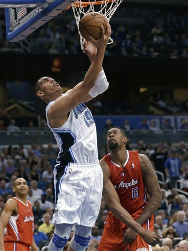 Orlando Magic's Gustavo Ayon (19), of Mexico, makes a shot in front of Los Angeles Clippers' DeAndre Jordan (6) during the first half of an NBA basketball game, Wednesday, Feb. 6, 2013, in Orlando, Fla. (AP Photo/John Raoux)