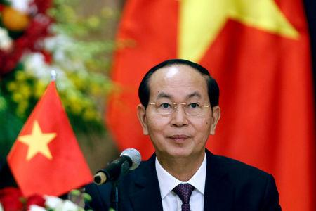 FILE PHOTO: Vietnam's President Tran Dai Quang attends a news conference in Hanoi