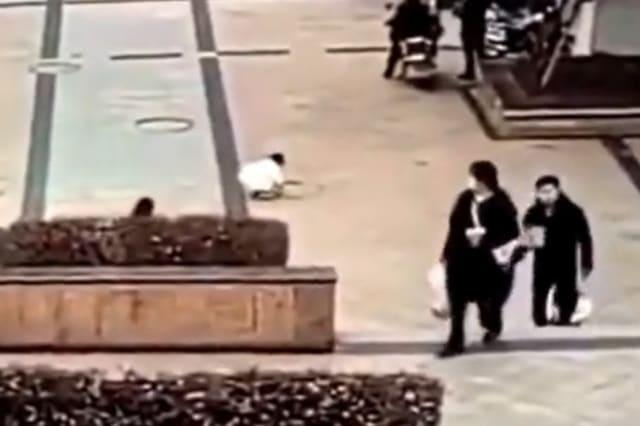 Manhole covers explode into the air after Chinese boy throws lit firecracker down sewer