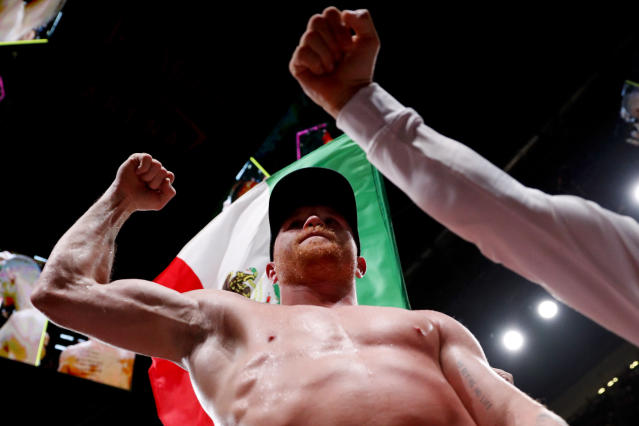 Canelo Alvarez, of Mexico, celebrate his win over Daniel Jacobs in a middleweight title boxing match Saturday, May 4, 2019, in Las Vegas. (AP Photo/John Locher)