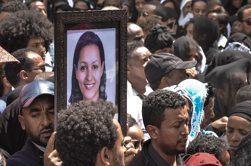 Mourners in Addis Ababa, Ethiopia carry portraits of victims from the Ethiopian Airlines crash (AFP Photo/Samuel HABTAB)