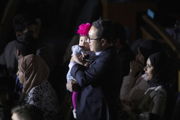 A delegate arrives with his daughter for a High-level meeting on the occasion of the 30th anniversary of the adoption of the Convention on the Rights of the Child, Wednesday, Nov. 20, 2019 at United Nations headquarters. (AP Photo/Mary Altaffer)