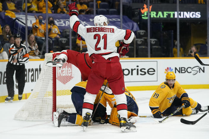 Carolina Hurricanes right wing Nino Niederreiter (21) celebrates after teammate Vincent Trocheck scored against the Nashville Predators during the first period in Game 4 of an NHL hockey Stanley Cup first-round playoff series Sunday, May 23, 2021, in Nashville, Tenn. (AP Photo/Mark Humphrey)