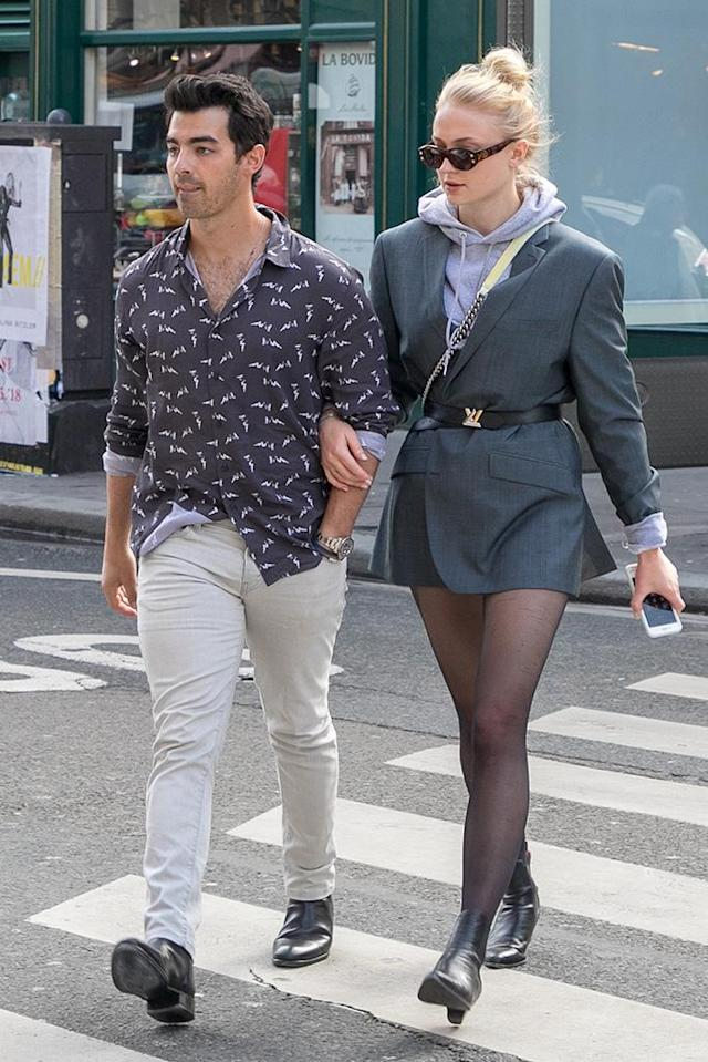 <p>The engaged lovebirds were seen strutting their stuff and arriving at the Espace Kiliwatch store on Monday in Paris, France. (Photo: Marc Piasecki/GC Images) </p>