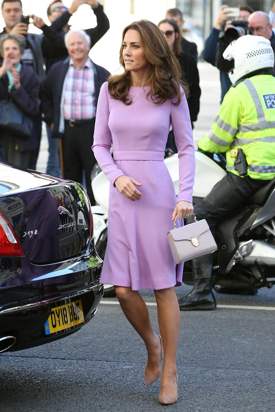 """The Duchess paired her Emilia Wickstead """"Kate"""" dress with an Aspinal bag. Photo: Getty"""