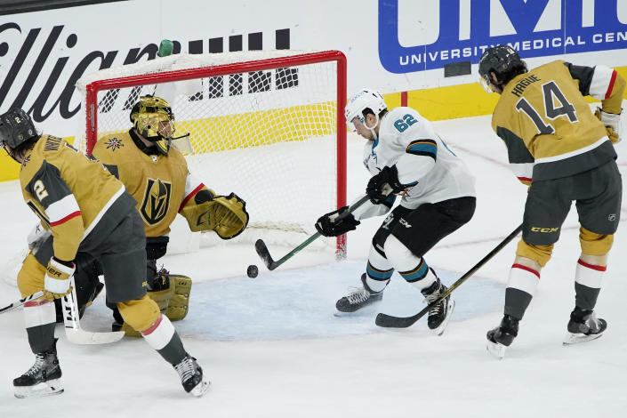 San Jose Sharks right wing Kevin Labanc (62) scores on Vegas Golden Knights goaltender Marc-Andre Fleury (29) during the second period of an NHL hockey game Wednesday, March 17, 2021, in Las Vegas. (AP Photo/John Locher)