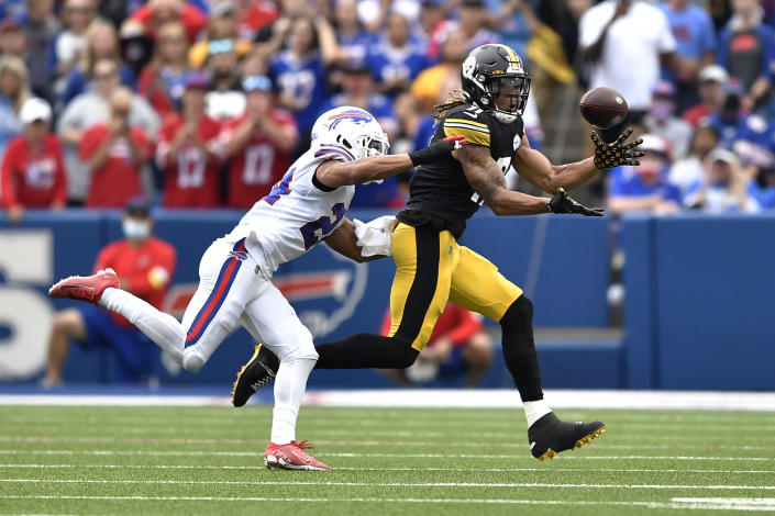 Pittsburgh Steelers wide receiver Chase Claypool (11) makes a catch with Buffalo Bills cornerback Taron Johnson defending during the second half of an NFL football game in Orchard Park, N.Y., Sunday, Sept. 12, 2021. The Steelers won 23-16. (AP Photo/Adrian Kraus)