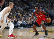 Toronto Raptors forward OG Anunoby, right, drives the lane as Denver Nuggets forward Mason Plumlee defends in the first half of an NBA basketball game Sunday, March 1, 2020. (AP Photo/David Zalubowski)