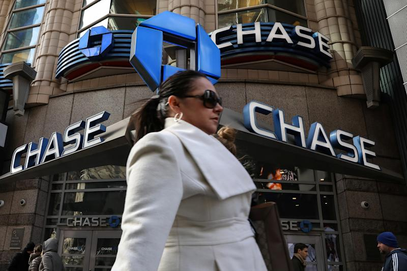 A woman passes by a Chase bank in Times Square in New York City, U.S., March 7, 2019. REUTERS/Brendan McDermid