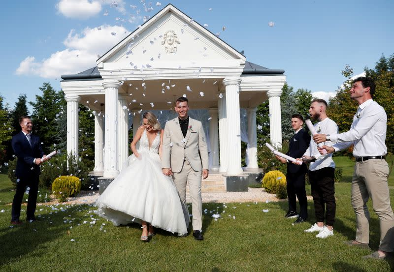 Uti and Dragoner celebrate their wedding ceremony as the coronavirus disease (COVID-19) restrictions are eased in Biri