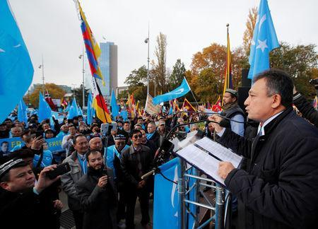 Dolkun Isa, President of the World Uyghur Congress, speaks during a demonstration against China during its Universal Periodic Review by the Human Rights Council in front of the United Nations Office in Geneva, Switzerland, November 6, 2018. REUTERS/Denis Balibouse