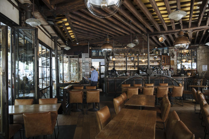 Inside Le Jaures restaurant a day prior the nationwide reopening of the restaurants interior, in Paris, France, Tuesday, June 8, 2021. (AP Photo/Lewis Joly)