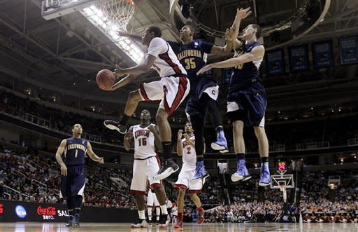 UNLV guard Bryce Dejean-Jones, third from right, shoots against California forwards Richard Solomon (35) and David Kravish during the first half of a second-round game in the NCAA college basketball tournament in San Jose, Calif., Thursday, March 21, 2013. (AP Photo/Jeff Chiu)
