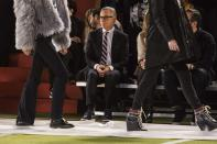 Designer Tommy Hilfiger watches on during rehearsals before presenting his Fall/Winter 2015 collection at the New York Fashion Week February 16, 2015. Shunning the traditional catwalk, Mr. Hilfiger instead presented his collection on a mock American Football field. REUTERS/Andrew Kelly (UNITED STATES - Tags: FASHION ENTERTAINMENT)