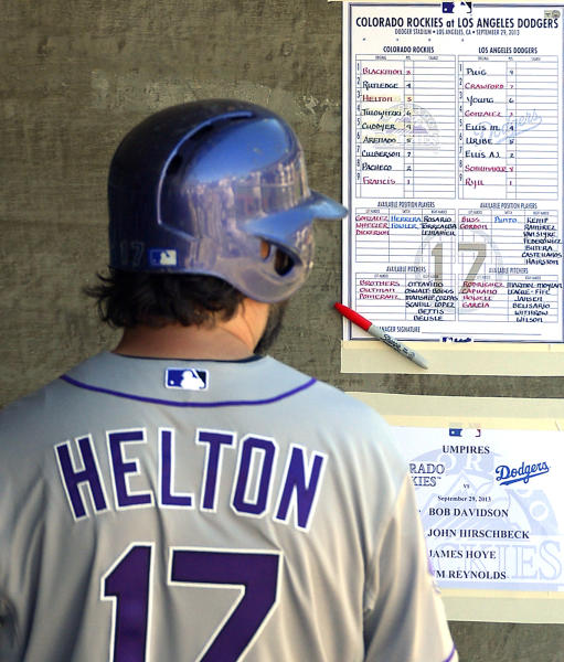 Colorado Rockies first baseman Todd Helton looks at the lineup prior to the Rockies' baseball game against the Los Angeles Dodgers, Sunday, Sept. 29, 2013, in Los Angeles. Helton is retiring after the season. (AP Photo/Mark J. Terrill)
