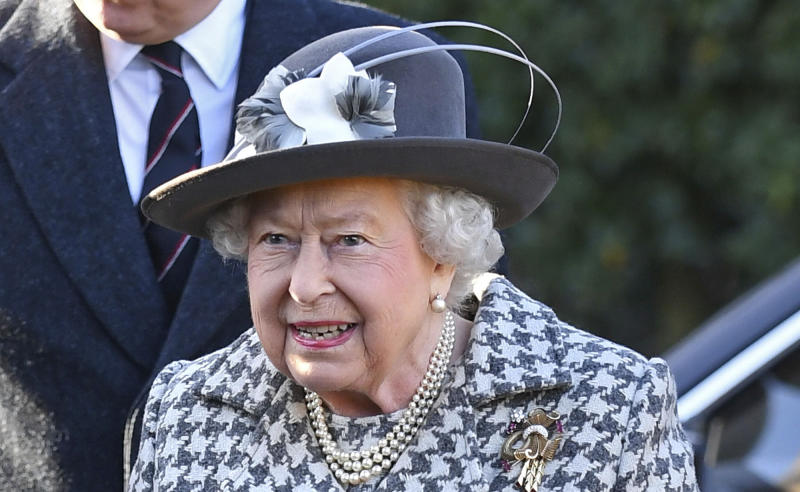 """Britain's Queen Elizabeth II arrives at St Mary the Virgin, in Hillington, England, to attend a Sunday church service, Sunday, Jan. 19, 2020. Buckingham Palace says Prince Harry and his wife, Meghan, will no longer use the titles """"royal highness"""" or receive public funds for their work under a deal that allows them to step aside as senior royals. (Joe Giddens/PA via AP)"""