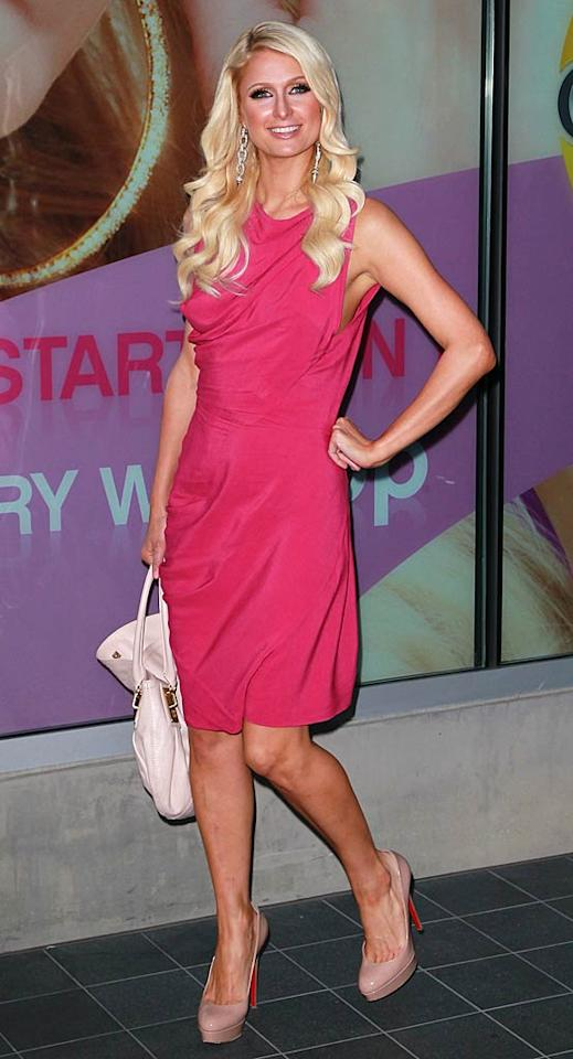 """Paris easily earned herself a second appearance in this week's 2 Hot 2 Handle fashion extravaganza when she sashayed through Santa Monica, California, in this bubble gum-pink cocktail dress and nude, patent leather Christian Louboutins. Is it just me, or is she looking better than ever?! David Livingston/<a href=""""http://www.gettyimages.com/"""" target=""""new"""">GettyImages.com</a> - May 27, 2011"""