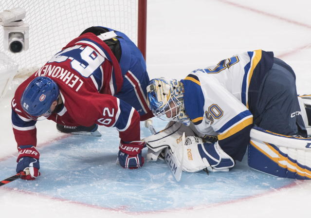 Montreal Canadiens' Artturi Lehkonen collides with St. Louis Blues goaltender Jordan Binnington during first period NHL hockey action in Montreal, Saturday, Oct. 12, 2019. (Graham Hughes/The Canadian Press via AP)